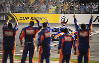 May 1, 2009; Richmond, VA, USA; NASCAR Nationwide Series driver Kyle Busch points to his crew as he celebrates after winning the Lipton Tea 250 at the Richmond International Raceway. Mandatory Credit: Mark J. Rebilas-