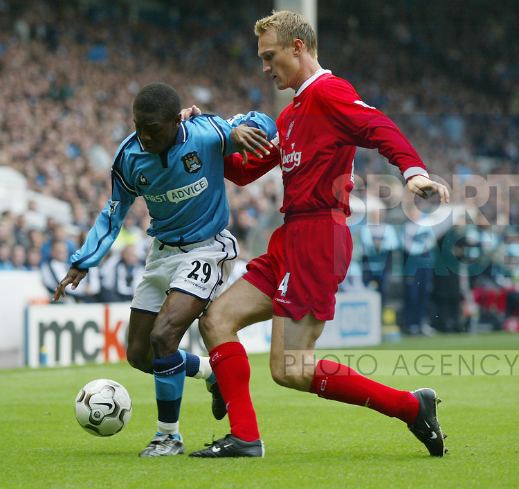 .Shaun Wright Phillips of Manchester City with Sami Hypia of Liverpool