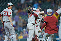 Oklahoma Sooners starting pitcher Dane Acker (28) hugs catcher Justin Mitchell (14) after throwing a no-hitter against the LSU Tigers in game seven of the 2020 Shriners Hospitals for Children College Classic at Minute Maid Park on March 1, 2020 in Houston, Texas. The Sooners defeated the Tigers 1-0. (Brian Westerholt/Four Seam Images)