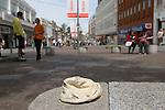 "Folkstone Triennial public art exhibition. Kent UK 2008. Tracey Emin ""Baby Things"". Baby cap hat on bench Sandgate Road pedestrianed precinct."