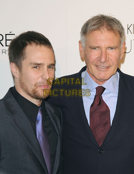 SAM ROCKWELL & HARRISON FORD .walks the carpet as Elle Honors Hollywood's Most Esteemed Women in the 17th Annual Women in Hollywood Tribute held at The Four Seasons Beverly Hills in Beverly Hills, California, USA, October 18th 2010..portrait headshot blue shirt red tie navy earring stud  black beard facial hair grey gray .CAP/RKE/DVS.©DVS/RockinExposures/Capital Pictures.