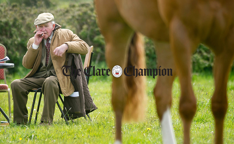 Liam Lynch from Clarecastle sitting things out during the Newmarket Show at the weekend. Photograph by Declan Monaghan