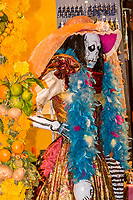Oaxaca; Mexico; North America.  Day of the Dead Celebrations.  Skeleton Mannequin Stands Outside Shop Selling Souvenirs, Toys, and Jewelry.