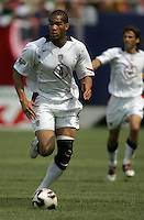 July 24, 2005: East Rutherford, NJ, USA: USMNT defender Oguchi Onyewu (4) sprints up the field during the CONCACAF Gold Cup Finals at Giants Stadium.  The USMNT won 3-1 on penalty kicks.