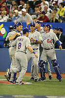 March 7, 2009:  Nick Punto (8), Vinny Rottino (10), Alex Liddi (14) and Francisco Cervelli (64) of Italy during the first round of the World Baseball Classic at the Rogers Centre in Toronto, Ontario, Canada.  Venezuela defeated Italy 7-0 in both teams opening game of the tournament.  Photo by:  Mike Janes/Four Seam Images