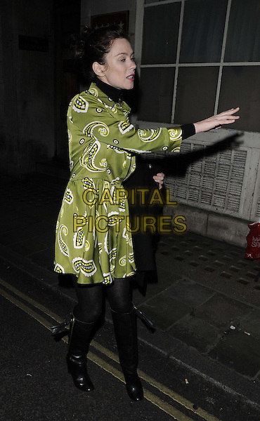Anna Friel .leaving after the evening performance of 'Uncle Vanya', Vaudeville Theatre, The Strand, London, England, UK, .21st December 2012..full length green shirt dress paisley print black knee high boots tights polo neck hand funny eyes shut blinking  .CAP/CAN.©Can Nguyen/Capital Pictures.