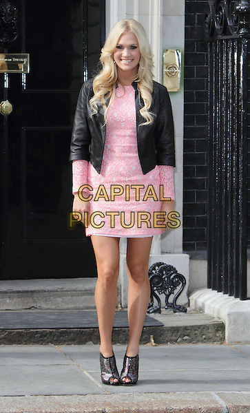 American Country singer and 5 times Grammy winner, Carrie Underwood, visits 10 Downing Street, London - June 20th 2012.full length dress peep toe ankle boots pink white print black jacket  .CAP/JIL.©Jill Mayhew/Capital Pictures
