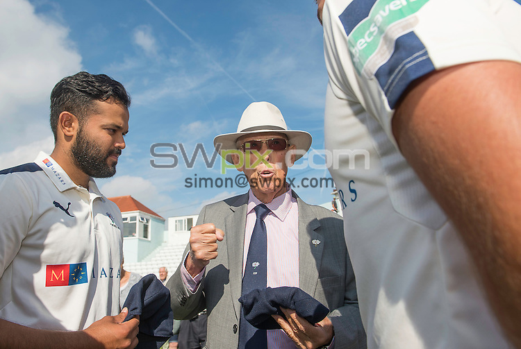 Picture by Allan McKenzie/SWpix.com - 23/08/2016 - Cricket - Specsavers County Championship - Yorkshire County Cricket Club v Nottinghamshire County Cricket Club - North Marine Road, Scarborough, England - Yorkshire President John Hampshire prepares to hand county caps to Azeem Rafiq & Jack Leaning.