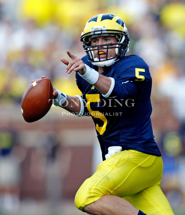 Michigan quarterback Tate Forcier (5) directs his receivers for a pass in the second quarter of an NCAA college football game with Notre Dame, Saturday, Sept. 12, 2009, in Ann Arbor. (AP Photo/Tony Ding)