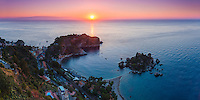 Panoramic photo of Isola Bella Beach and Isola Bella Island at sunrise, Taormina, Sicily, Italy, Europe. This is a panoramic photo of Isola Bella Beach and Isola Bella Island at sunrise, Taormina, Sicily, Italy, Europe. Isola Bella Beach is the most popular beach at Taormina and is a fantastic spot for panoramic views of sunrise over the Ionian Sea (part of the Mediterranean Sea).