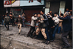 A young soldier is seized by demonstrators in 24 of Esfand Square after the army opens fire on the funeral cortege of a 27-year-old professor killed the day before. Tehran, December 27, 1978