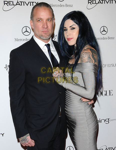 "JESSE JAMES & KAT VON D .attends the Art of Elysium 4th Annual Charity Gala ""Heaven"" held at The Annenberg Building at The California Science Center in Los Angeles, California, USA, January 15th 2011..half length black suit tie couple arm around  grey gray herve leger bandage dress  tattoos off the shoulder long sleeve                                      .CAP/RKE/DVS.©DVS/RockinExposures/Capital Pictures."