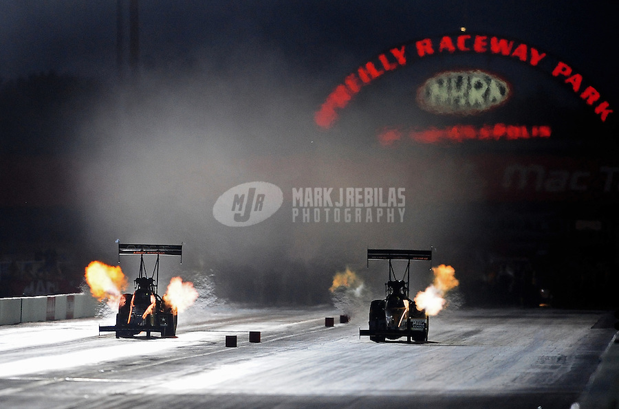 Sept. 3, 2010; Clermont, IN, USA; NHRA top fuel dragster driver Tony Schumacher (left) races alongside Doug Kalitta during qualifying for the U.S. Nationals at O'Reilly Raceway Park at Indianapolis. Mandatory Credit: Mark J. Rebilas-