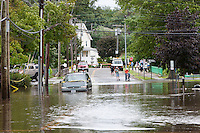 MAMARONECK, NY - AUGUST 28: Local residents survey flooding on Jefferson Street in the Village of Mamaroneck, New York on Sunday August 28, 2011 in the aftermath of Hurricane Irene.