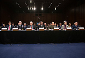 """From left to right: United States Secretary of the Army Dr. Mark T. Esper; US Army General Mark A. Milley, Chief of Staff of the Army; US Secretary of the Navy Richard V. Spencer; US Navy Admiral John M. Richardson, Chief of Naval Operations; US Marine Corps General Robert B. Neller, Commandant of the Marine Corps; US Secretary of the Air Force Heather Wilson; and US Air Force General David L. Goldfein, Chief of Staff of the Air Force testify before the US Senate Committee on Armed Services during a hearing on """"Chain of Command's Accountability to Provide Safe Military Housing and Other Building Infrastructure to Service members and Their Families"""" on Capitol Hill in Washington, DC on Thursday, March 7, 2019.<br /> Credit: Ron Sachs / CNP"""