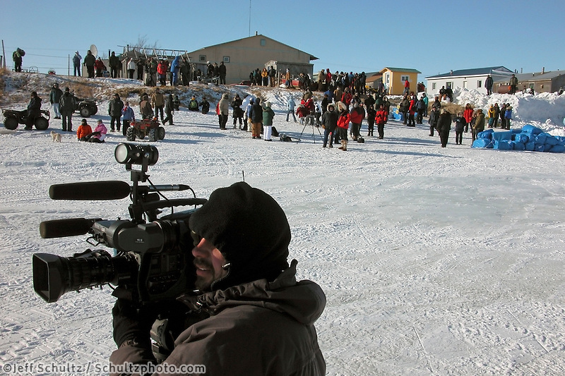 Spectators and media wait in Unalakleet for the first team to arrive. Photo by Jon Little.