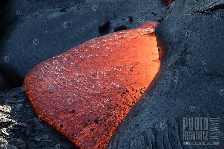 A close-up of molten lava contrasted with cooled lava on the coastal plains of Pulama Pali (part of Holei Pali), Hawai'i Volcanoes National Park, Puna, Hawai'i Island, December 2017.
