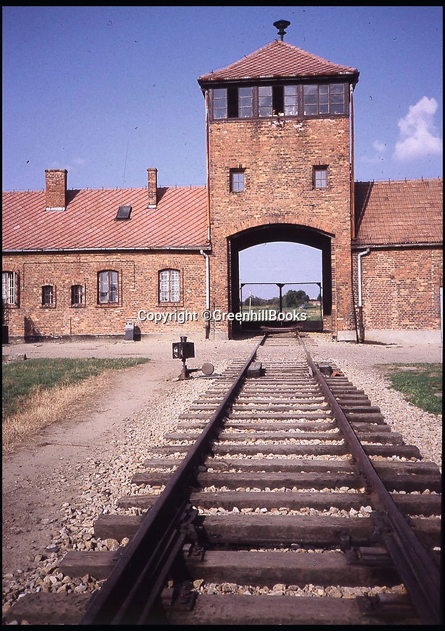 BNP.co.uk (01202 558833)<br /> Pic: GreenhillBooks/BNPS<br /> <br /> The railway tracks leading to the gate house at Birkenau extermination camp.<br /> <br /> The story of Hitler's Third Reich is told in a unique way in a new book which provides a fresh insight into the sinister regime through 100 objects.<br /> <br /> Included in the comprehensive list is Hitler's personal moustache brush which was taken from the bedroom of his Munich apartment after his death by his housekeeper Anni Winter. <br /> <br /> Historian Roger Moorhouse also reveals the bizarre tale of Nazi deputy leader Rudolf Hess' long johns which were seized by the British after his misjudged decision to fly to Britain in 1941 for 'peace' talks.<br /> <br /> They were confiscated by the British secret service for 'propaganda' purposes and have been locked away in the Imperial War Museum archives in London for the past 75 years.