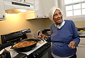Willie Mae Seaton cooks fried chicken for volunteers helping to rebuild her Katrina-devastated restaurant, Willie Mae's Scotch House, New Orleans, Sunday, March 4, 2007..(AP Photo/Cheryl Gerber).