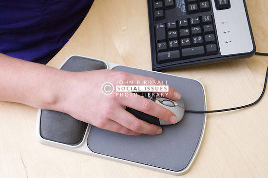 Office worker using a computer mouse,