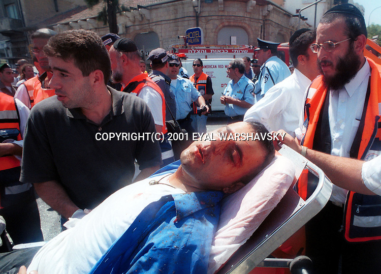 Israeli Medics treats a wounded Israeli after a suicide bombing at a Jerusalem restaurant Thursdays Aug 9 2001. PHOTO BY Eyal Warshavsky