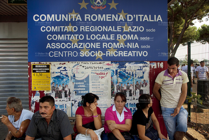 "Italy. Lazio region. Rome. Anagnina park with a sign "" Communita romena d'Italia"". On sunday afternoon, the romanian men and women, all immigrants, meet there and spend time together. Romanian immigration. Anagnina is the south-eastern terminus of Line A of the Rome Metro. It is located at the junction of the Via Tuscolana and the Via Anagnina, close to the depot of Osteria del Curato. 25.09.2011 © 2011 Didier Ruef"