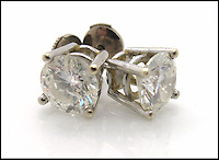 BNPS.co.uk (01202 558833)<br /> Pic: SheffieldAuctionGallery/BNPS<br /> <br /> ***Please use full byline***<br /> <br /> A Pair of Modern Single Stone Diamond Earstuds<br /> <br /> A &pound;110,000 haul of jewellery seized from the ringleader of a &pound;26million tobacco smuggling operation is to go under the hammer.<br /> <br /> The collection includes a luxurious 9-carat diamond ring valued at &pound;40,000 and four jewel-encrusted designer wristwatches collectively worth &pound;30,000.<br /> <br /> Also among the 30 lots are an &pound;8,000 4.5 carat single stone ring, large 7-carat ear studs worth &pound;15,000 and a bizarre solid gold baby's dummy worth &pound;500.<br /> <br /> The items were confiscated from Daniel Harty, the mastermind of a criminal gang jailed for smuggling 150 million cigarettes and two tonnes of low quality tobacco into the UK.<br /> <br /> Harty created a distribution network around the north of England transporting cigarettes to warehouses, storage yards and farms.<br /> <br /> Between them they evaded paying &pound;26million of duty.<br /> <br /> Harty, 30, from Doncaster, Yorks, was jailed in June last year for four and a half years after pleading guilty to conspiracy to evade excise duty.<br /> <br /> The jewellery was seized from Harty on his arrest in early 2011 under the Proceeds of Crime Act. A judge ordered it should be sold to satisfy a &pound;330,000 confiscation order.<br /> <br /> The auction is being held at Sheffield Auction Gallery on March 21.