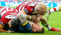 Warrington Wolves' Josh Charnley is tackled by Wigan Warriors' Ben Flower and Liam Farrell<br /> <br /> Photographer Alex Dodd/CameraSport<br /> <br /> Betfred Super League Round 15 - Magic Weekend - Wigan Warriors v Warrington Wolves - Saturday 19th May 2018 - St James' Park - Newcastle<br /> <br /> World Copyright &copy; 2018 CameraSport. All rights reserved. 43 Linden Ave. Countesthorpe. Leicester. England. LE8 5PG - Tel: +44 (0) 116 277 4147 - admin@camerasport.com - www.camerasport.com