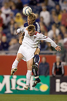 Taylor Twellman (Revolution) heads an assist on the Revolution only goal as Chris Leitch (MetroStars) defends. The NE Revolution defeated NY Metro Stars, 1-0, on September 24 at Gillette Stadium.