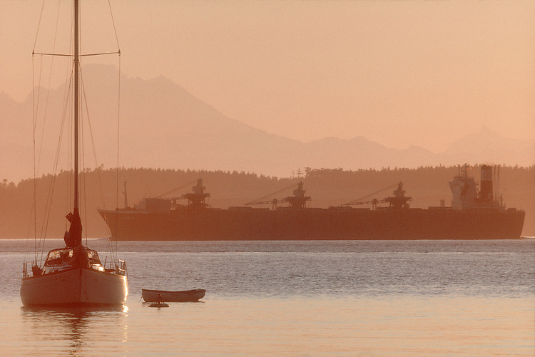 Puget Sound, freighter, sailboat, Mount Baker at dawn, Washington State, USA, Pacific Northwest, Inside Passage, bulk carrier outbound through Admiralty Inlet off Port Townsend, .