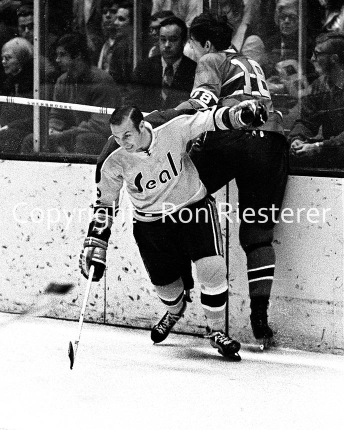 Seals vs Canadiens:Seals Gary Jarrett slams #18 Serge Savard into the boards.  (1970 photo/Ron Riesterer)