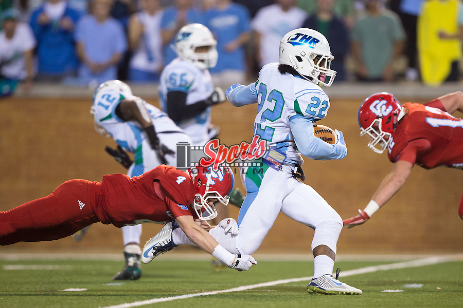 Andrew Phillips (22) of the J.H. Rose Rampants eludes the tackle attempt of Benjamin Brodowicz (4) of the Charlotte Catholic Cougars during first half action in the NCHSAA 4A State Championship at BB&T Field on December 12, 2015 in Winston-Salem, North Carolina.  The Cougars defeated the Rampants 27-20.  (Brian Westerholt/Sports On Film)