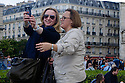 Paris, France. 09.05.2015. Women taking a selfie, Notre Dame, Paris, France.Photograph © Jane Hobson