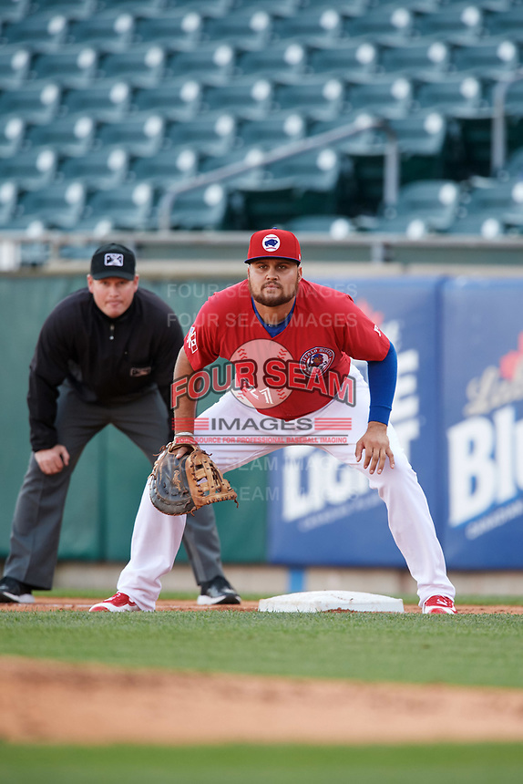 Buffalo Bisons first baseman Rowdy Tellez (21) holds a runner on as first base umpire Sean Barber looks on during a game against the Syracuse Chiefs on May 18, 2017 at Coca-Cola Field in Buffalo, New York.  Buffalo defeated Syracuse 4-3.  (Mike Janes/Four Seam Images)