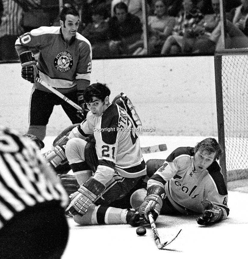 Seals Ron Stackhouse and Dick Redmond in front of net, Pittsburg Penguin's Dean Prentice. (1971 photo/Ron Riesterer)