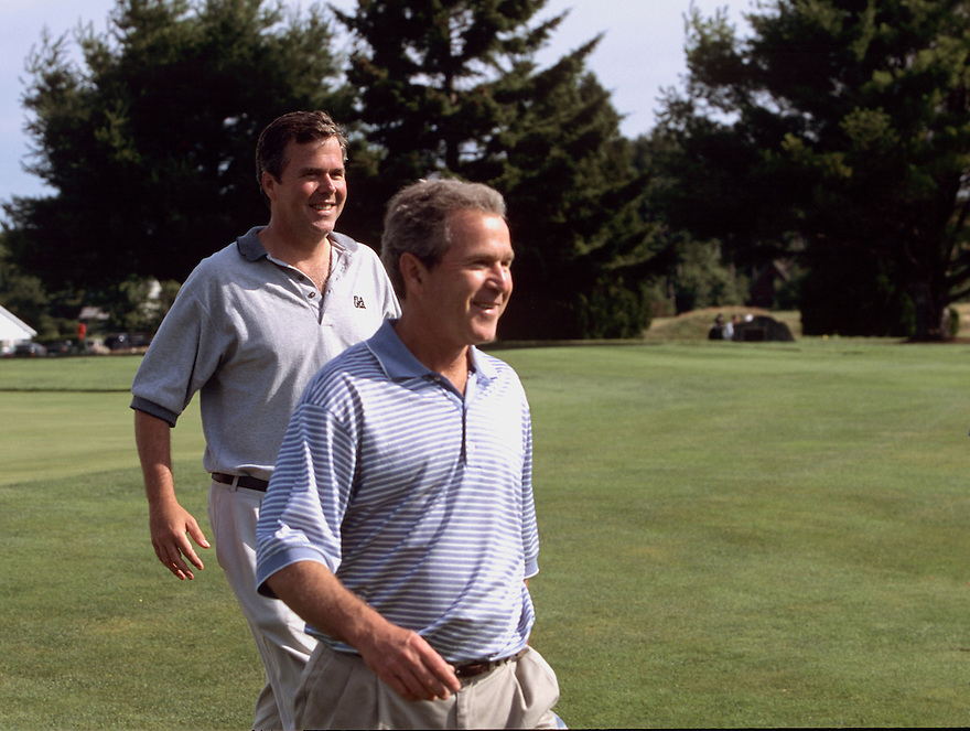 President George W. Bush and Florida Governor Jeb Bush  leave the 18th green after playing an early morning round at Cape Arundel Golf Club in Kennebunkport, Maine.