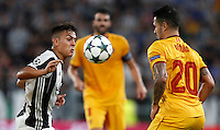 Calcio, Champions League: Juventus vs Siviglia: Torino, Juventus Stadium, 14 settembre 2016. <br /> Juventus&rsquo; Paulo Dybala, left, is challenged by Sevilla's Vitolo during the Champions League Group H football match between Juventus and Sevilla at Turin's Juventus Stadium, 16 September 2016.<br /> UPDATE IMAGES PRESS/Isabella Bonotto