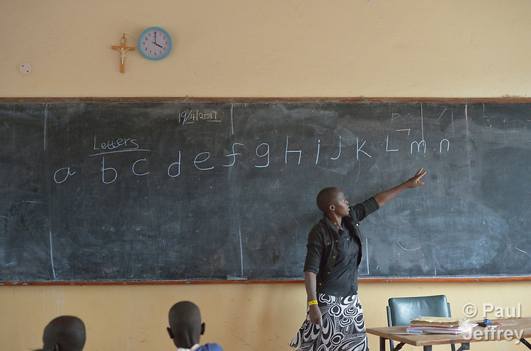A teacher points to letters on the blackboard in the Loreto Primary School in Rumbek, South Sudan. The Loreto Sisters began a secondary school for girls in 2008, with students from throughout the country, but soon after added a primary in response to local community demands.