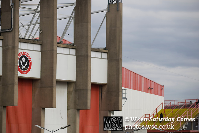 Sheffield United 2 Leeds United 0, 19/03/2011. Bramall Lane, Championship. A solitary Sheffield United supporter making his way up the steps into the Kop Stand at the club's Bramall Lane ground prior to the Npower Championship fixture against Leeds United. The home team won the game by two goals to nil watched by a crowd of 23,728. Bramall Lane is the world's oldest professional football ground and at one time hosted both football and cricket. Photo by Colin McPherson.