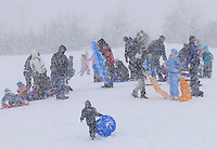 Children and parents take to the hills of Sarnia Centennial Park to enjoy a sled ride in freshly fallen snow.