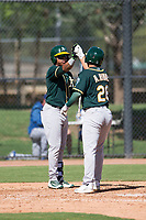 Oakland Athletics second baseman Alexander Campos (6) congratulates Alfonso Rivas (26) after hitting a home run during an Instructional League game against the Los Angeles Dodgers at Camelback Ranch on October 4, 2018 in Glendale, Arizona. (Zachary Lucy/Four Seam Images)