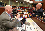 Nevada Assembly Republicans Randy Kirner, left, and Ira Hansen work on the Assembly floor at the Legislative Building in Carson City, Nev., on Monday, Feb. 9, 2015. <br /> Photo by Cathleen Allison