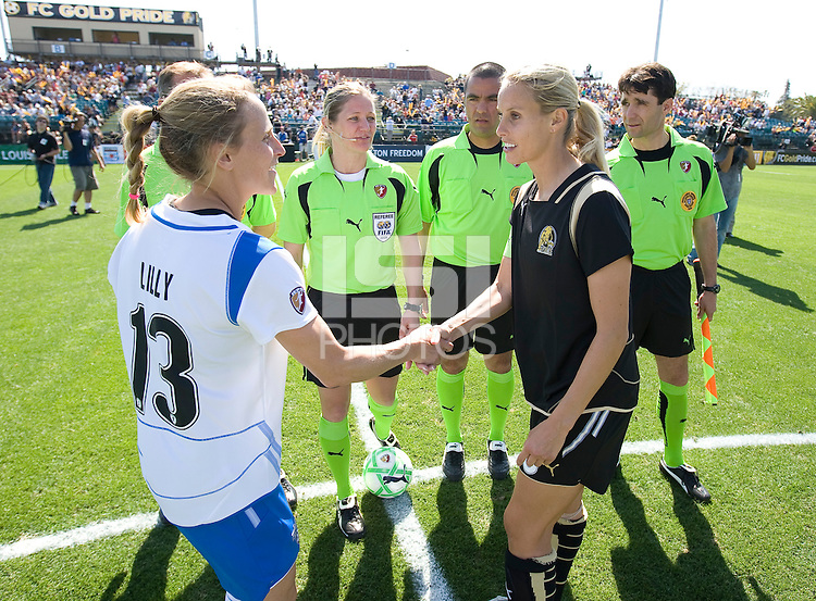 Kristine Lilly and Leslie Osborne shake hands before the match. FC Gold Pride defeated the Boston Breakers 2-1 at Buck Shaw Stadium in Santa Clara, California on April 5th, 2009.