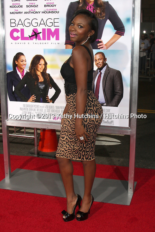 """LOS ANGELES - SEP 25:  Naturi Naughton at the """"Baggage Clain"""" Premiere at Regal 14 Theaters on September 25, 2013 in Los Angeles, CA"""