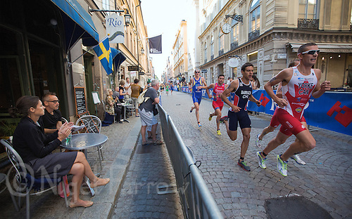 25 AUG 2013 - STOCKHOLM, SWE - Andrew Yorke (CAN) (right) of Canada runs through the streets of Gamla Stan, the old part of Stockholm, Sweden, during the elite men's ITU 2013 World Triathlon Series round (PHOTO COPYRIGHT © 2013 NIGEL FARROW, ALL RIGHTS RESERVED)