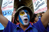 Un unidentified protestor with the Argentinean flag panted in his face demonstrates outside the Supreme Court in Buenos Aires, January 17,2002. Protestors demand the Supreme Court to quit, blaming them from corruption, and asking the new President Duhalde to go. Photo by Quique Kierszenbaum....