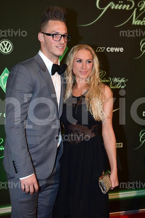 FUSSBALL   1. BUNDESLIGA   SAISON 2012/2013    Marko Arnautovic  posiert mit Ehefrau Sarah anlaesslich der Gruen Weissen Nacht vom SV Werder Bremen am 02.02.2013