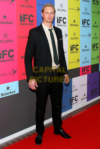 ALEXANDER SKARSGARD.IFC's 2009 Indie Film Celebration following Film Independent's Spirit Awards held at Shutters on the Beach, Santa Monica, California, USA..February 21st, 2009.full length black suit .CAP/ADM/TC.©T. Conrad/AdMedia/Capital Pictures.