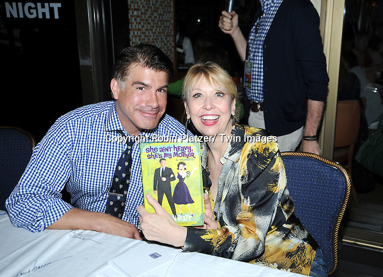 Bryan Batt and Julie Halston posing for photographers at The Broadway Cares/ Equity Fights Aids 24th Annual Broadway Flea Market & Grand Auction on September 26, 2010 in Shubert Alley..photo by Robin Platzer/ Twin Images.212-935-0770