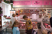Women making a selection in Polish meat market on Lutomierska Street Balucki District Lodz Central Poland